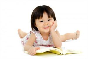 Preschool girl with book
