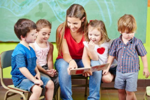 Child Care Provider reading to kids