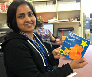 library volunteer processing new books