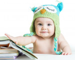 Baby with owl hat and books