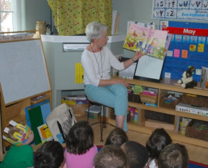 BookShare volunteer reading to kids