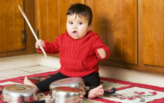 Baby banging on pots