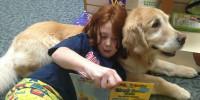 girl reading to dog