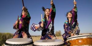 Three women drumming
