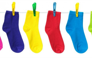 colorful socks hanging on clothing line