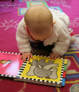 baby looking at book