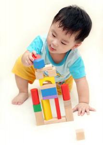 Asian toddler building block tower Dreamstime