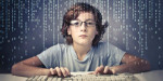 Teen typing on a computer keyboard with lines of code behind his head