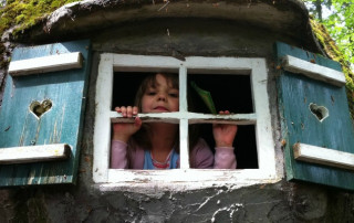 girl peeking out of window
