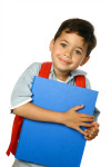 school age boy with blue notebook