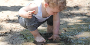 child in mud