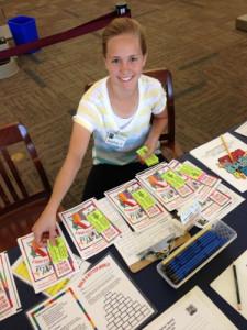 teen making summer reading packets