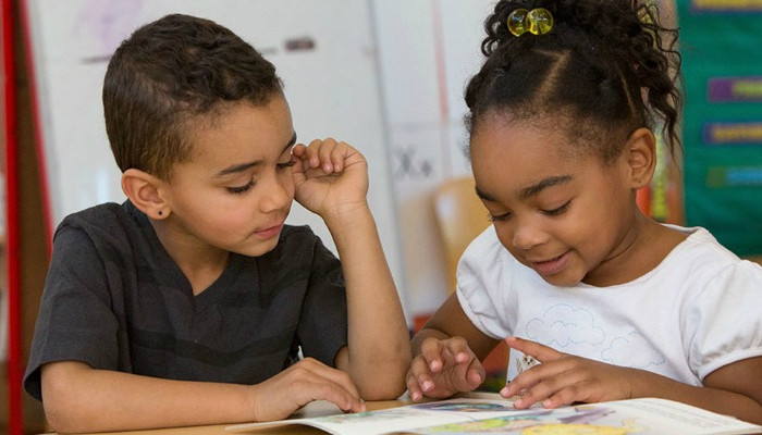 boy and girl reading
