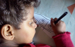young boy drawing