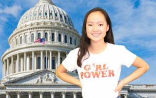 Teen girl with a Girl Power shirt standing in front of the US Capitol