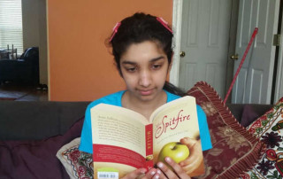 Teen reading a book