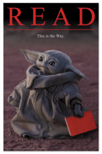 baby yoda creature with a book