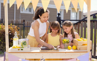 woman and children at lemonade stand